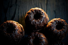 Fresh lush chocolate cupcakes are on the background of dark wood.Studio Stock Photography