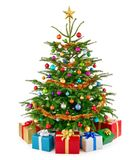 Fresh lush Christmas tree with colorful gift boxes stock photo