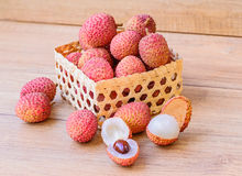 Fresh lychee in bamboo basket on a wooden background Stock Photography