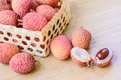 Fresh lychee in bamboo basket on a wooden background Royalty Free Stock Photography