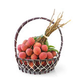 Fresh lychee fruit in basket  on white background Stock Photo