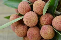 Fresh lychee fruit on wooden background, detail. Fresh lychee fruit on wooden background Stock Photography