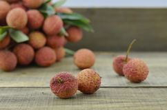 Fresh lychee fruit on wooden table. Fresh lychee fruit on wooden background Stock Photos
