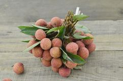 Fresh lychee fruit on wooden table. Fresh lychee fruit on wooden background Stock Images