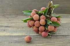 Fresh lychee fruit on wooden table. Fresh lychee fruit on wooden background Stock Image