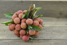 Fresh lychee fruit on wooden table. Fresh lychee fruit on wooden background Royalty Free Stock Image