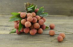 Fresh lychee fruit on wooden table. Fresh lychee fruit on wooden background Royalty Free Stock Photo