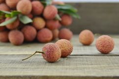 Fresh lychee fruit on wooden table. Fresh lychee fruit on wooden background Royalty Free Stock Images