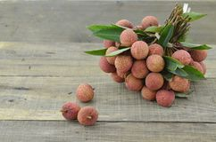 Fresh lychee fruit on wooden table. Fresh lychee fruit on wooden background Stock Photography