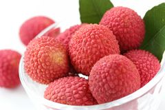 Fresh lychees in glass bowl Stock Photos