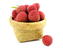 Fresh lychees in a wicker basket on a white background. Lychees in a wicker basket on a white background stock images