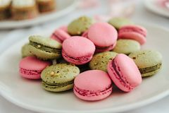 Fresh macarons on white plate. Close up Royalty Free Stock Photo