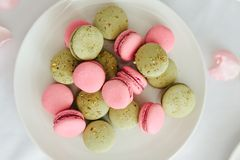 Fresh macarons on white plate. Close up Stock Images