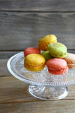Fresh macaroon on glass stand Royalty Free Stock Photo