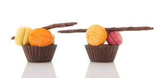Fresh macaroons in chocolate cups Royalty Free Stock Photo