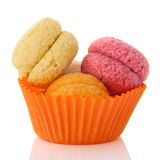 Fresh macaroons in orange cup Royalty Free Stock Photography
