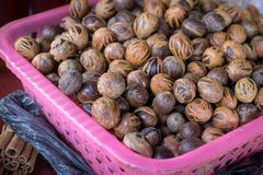 Fresh mace and nutmeg with selective focus. Basket full of fresh mace and nutmeg with selective focus at market stall Royalty Free Stock Images