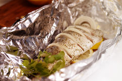 Fresh mackerel prepared for oven cooking, marinated with spices, salt and lemon. Raw fish in foil. Stock Image