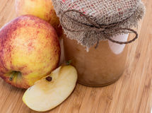 Fresh made applesauce on wooden background Royalty Free Stock Photo