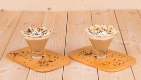 Fresh made Banana Milkshake on wooden background Royalty Free Stock Photography