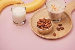 Fresh made Banana smoothie on pink background.  royalty free stock image