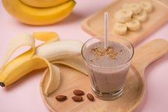 Fresh made Banana smoothie on pink background.  stock photo