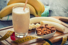 Fresh made Banana smoothie. On wooden background stock image
