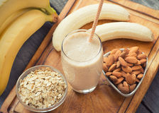 Fresh made Banana smoothie. On wooden background royalty free stock photography