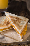 Fresh made Cheese Sandwich. (selective focus) on an old wooden table Stock Photos
