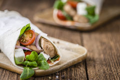 Fresh made Chicken Wrap. (selective focus) on an old wooden table Royalty Free Stock Photography