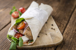 Fresh made Chicken Wrap. (selective focus) on an old wooden table Royalty Free Stock Photo