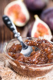 Fresh made Fig Jam. (detailed close-up shot) with some fresh fruits stock photo
