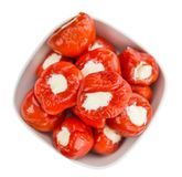 Fresh made Filled Pimientos over white. Fresh made Red Pepper stuffed with cheese isolated on white background close-up shot Royalty Free Stock Images