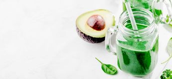 Fresh made green smoothie in bottle stock image