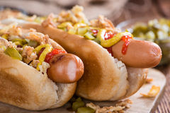 Fresh made Hot Dog with fried onions and cucumbers Stock Photo