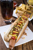 Fresh made Hot Dog with fried onions and cucumbers Stock Photography