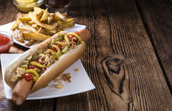 Fresh made Hot Dog with fried onions and cucumbers Royalty Free Stock Photo