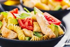 Fresh made italian pasta salad with chicken stock photos