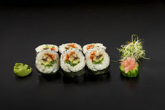 Fresh made Japanese sushi rolls decorated Royalty Free Stock Photos