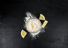 Fresh made Lemon powder on a slate slab close-up shot; selectiv Royalty Free Stock Photo