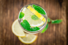 Fresh made Lemonade on a rustic background Royalty Free Stock Photo