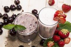 Fresh made Milkshakes. (Strawberry and Cherry royalty free stock photography