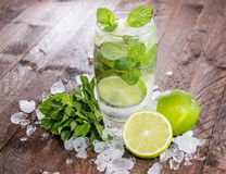 Fresh made Mojito with ingredients Royalty Free Stock Photos