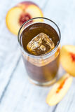 Fresh made peach ice tea (selective focus) Royalty Free Stock Photos