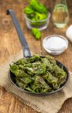 Fresh made Pimientos de Padron on a rustic background Royalty Free Stock Photos