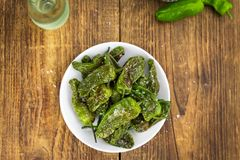 Fresh made Pimientos de Padron on a rustic background Stock Photo