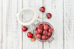 Fresh made Preserved Cherries on a rustic background Stock Photos