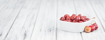 Fresh made Preserved Cherries on a rustic background Royalty Free Stock Images