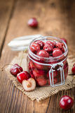 Fresh made Preserved Cherries on a rustic background Royalty Free Stock Image