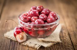 Fresh made Preserved Cherries on a rustic background Royalty Free Stock Photos